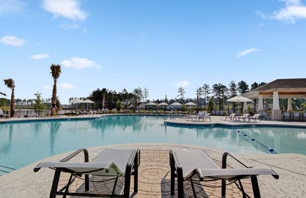 Four Seasons at Lakes of Cane Bay Outdoor Pool with Lounge Chairs