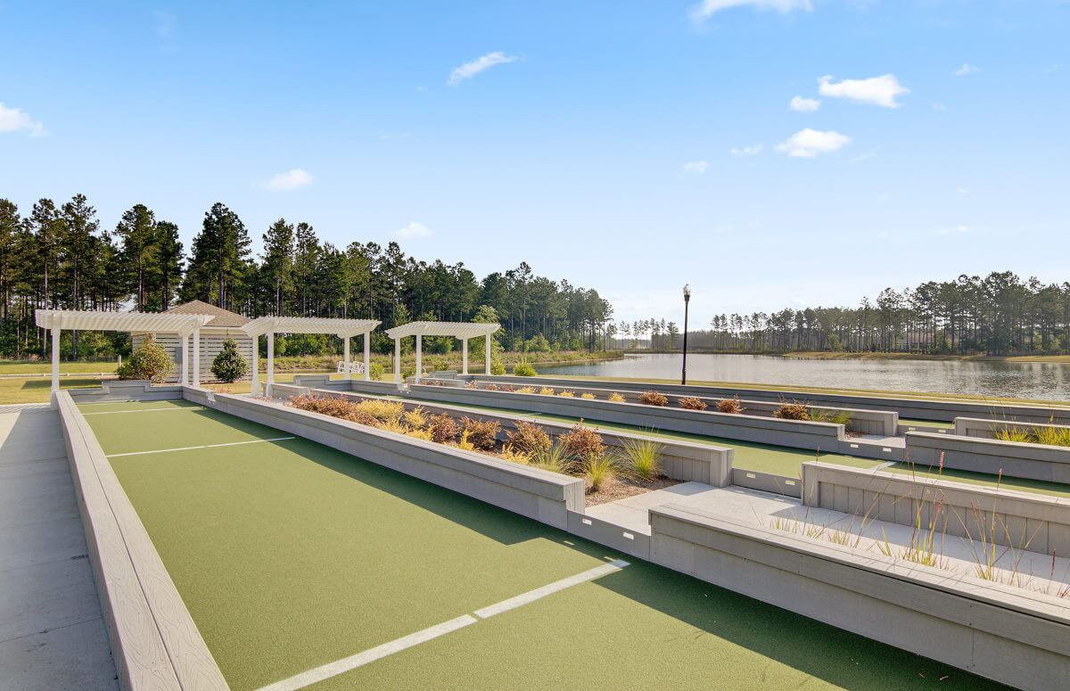 Four Seasons at Lakes of Cane Bay Shuffleboard Courts by the Lake